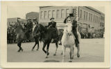 Three people riding horses in the Farm Festival parade, N.D.