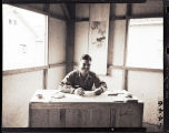 Bill Shemorry at desk in Press hostel, China