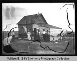 Family outside home, Wildrose, N.D.