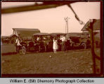 Gathering around automobiles, Northwest Williston, N.D.