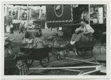 Edward Weiss in cart on children's ride, Wells County Fair, Fessenden, N.D.