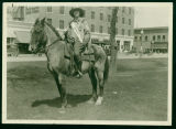 Elsie Brandt, Miss Mandan, on a horse in front of the Lewis and Clark Hotel, Mandan, N.D.