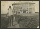 Melvin T. Rye in front of school, Nome, N.D.