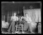 Two women in homestead shack, Turtle Lake, N.D.