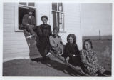 Unidentified group on ladder outside house or schoolhouse, probably near Rhame, N.D.