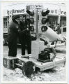 Sgt. Ray Ulrich and Lt. Charles Anderson installing lights on 4th and Broadway, Bismarck, N.D.