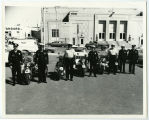 Bismarck Police Department with motorcycles outside World War Memorial building, Bismarck, N.D.