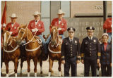 Bismarck Police 'posse' Charles Anderson, Chief Ken Medeiros and Mrs. Curtis in front of police department,