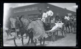 Chrysler-Plymouth Floating Power Odou and Arnold horse-drawn float in parade, Hettinger, N.D.