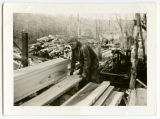 Ed Stolson working at his sawmill south of Sanish, N.D.