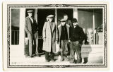 Homer Parris, Hagen Carlson, Bob Bohn, James Schuler in front of store, Sanish, N.D.