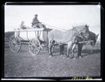 Man in 'C R Monson, Adams NoDak' wagon