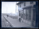 Men outside Rolette train depot, Rolette, N.D.