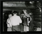 Fred Martin playing accordion at Frank Wetzstein's cabin north of Mandan, N.D.