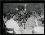 Gene Autry with group eating at Frank Wetzstein's cabin north of Mandan, N.D.