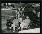 Gene Autry, Fred Martin and Jerry Scoggins at Frank Wetzstein's cabin north of Mandan, N.D.