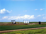 Pumpjack and 3 tanks, North Dakota oilfield