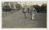 Boy and girl dressed up as Native Americans, running