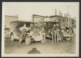 North Dakota Power & Light Company and Hughes Electric Company trucks and drivers, Bismarck,...