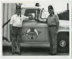 Kem Shriners wearing hats with truck, Rugby, N.D.