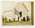 Rose C. MacDiarmid and students in front of #3 Girard Lake District 24 school, Pierce County, N.D.