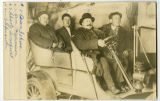 Unidentified man, Charly Tromquist, Dan Halverson, Oscar Johnson in an automobile