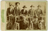Unidentified men with bicycles
