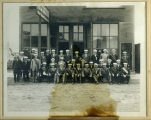Sons of Norway Odin Lodge group portrait in front of Pierce County Tribune building, Rugby, N.D.
