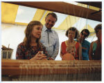Governor George Sinner and others inside weaving exhibition booth, Bismarck, N.D.