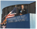 Governor George Sinner speaking at podium, North Dakota Centennial celebration, Bismarck, N.D.