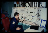 Combat crew at communications console, launch facility control station