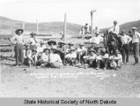 Bunch of wild cowboys, sitting in the sun, central S.D. roundup