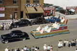 Auto Dealers float in Elks Parade on 500 block of Main Avenue, Bismarck, N.D.