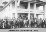 Large group of land buyers in front of hotel in Flasher, N.D.