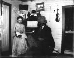 Nancy Christenson and man in her homestead shack near Mandan, N.D.