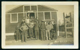 Group of men in front of barracks building, Civilian Conservation Corps Company 1723, Walker, Minn.