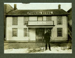Man with sled in front of Pembina House, Pembina, N.D.