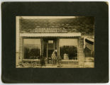 Three men in front of John Heneman's The New One Price Store, Pembina, N.D.