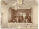 Actors in costume on stage, likely in St Vincent, Minn.