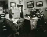 Russell Reid and Margaret Rose in office, Liberty Memorial Building, Bismarck, N.D.