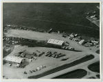 Aerial over salvage yard or machine shop, Tioga, N.D.