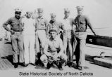 Six Marines and one sailor aboard the U.S.S. North Dakota
