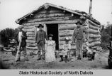 Log cabin and Metis family, Devils Lake, N.D.