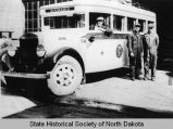 Men with Interstate Transportation Company bus, Bismarck, N.D.
