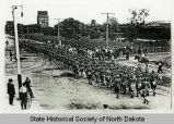 Soldiers marching up street, Dickinson, N.D.