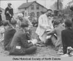 Arthur G. Sorlie and Charles C. Moore speaking to schoolchildren, Bonners Ferry, Idaho
