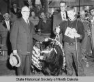 Norman Brunsdale, David Sauer, and champion heifer at North Dakota Winter Show, Valley City, N.D.