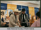 Arthur Link and Buckshot Hoffner at State Fair booth, Minot, N.D.