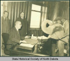 John Moses, Archie O. Johnson and elephant in governor's office, Bismarck, N.D.