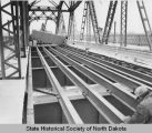 Laying new bridge floor on Liberty Memorial Bridge, Bismarck, N.D.